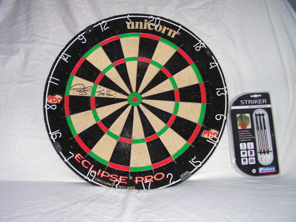Dartboard signed by Phil the Power Taylor, with darts.