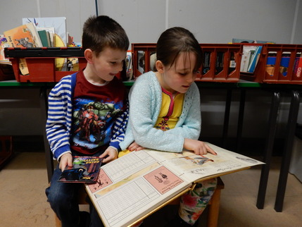 Children reading in the book store at the Village Hall