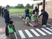 Greenacres children show how to cross the new play road