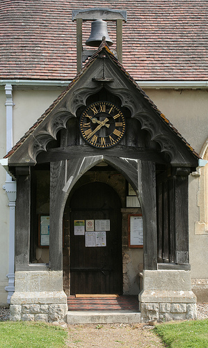 Church entrance and clock at St Giles Langford